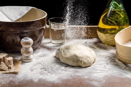 Sprinkling flour pizza dough