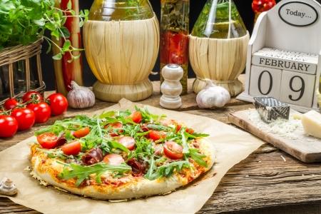 Preparing homemade pizza with ham photo