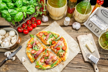 Split baked pizza with fresh vegetables photo