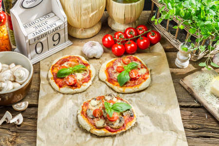 Fresh ingredients for a mini pizza photo