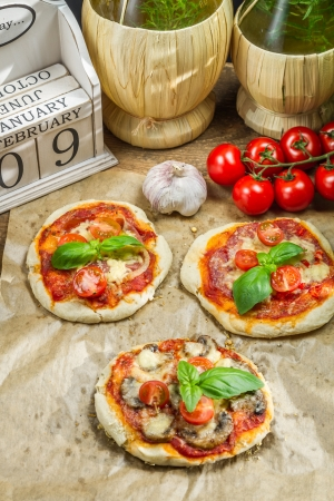 Fresh ingredients for a mini pizza with mushrooms photo