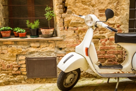 italy culture: Vintage scene with Vespa on old street