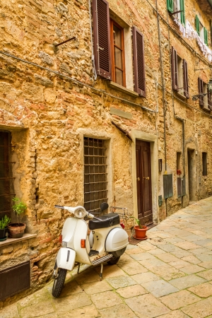 tuscany: old scooter on a small street in the old town, Italy Stock Photo