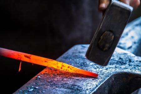 Blacksmith at work in anvil Stock Photo - 20152928