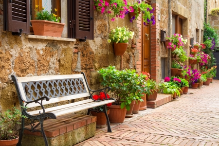 Beautiful street decorated with flowers in Italy photo