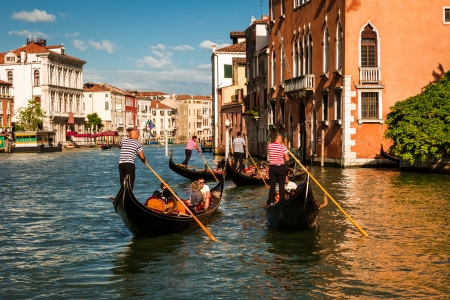 Gondoliers floating on a Grand Canal, Venice, Italy