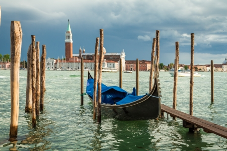Gondola moored on the Grand Canal in Venice photo