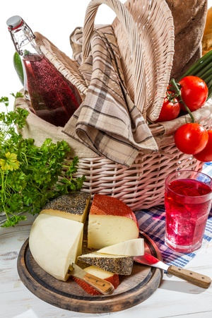 Basket full of fresh vegetables and cheese photo