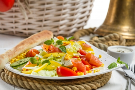 emaciated: Closeu of healthy salmon salad made of fresh vegetables