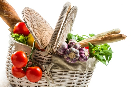 Spring basket full of fresh vegetables photo