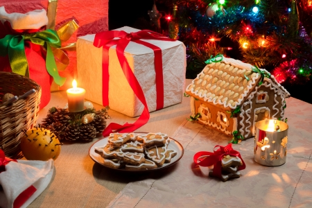 Presents and gingerbread cookies on the table on Christmas Eve Stock Photo - 20543726