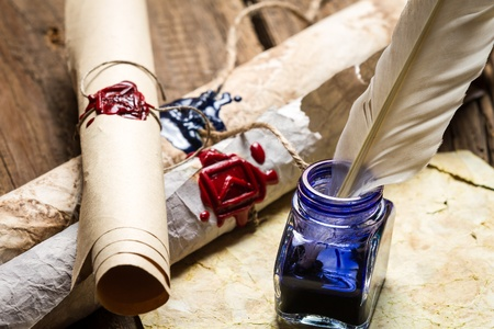 beeswaxseals: Closeup of ancient scrolls writing by feather with blue ink Stock Photo