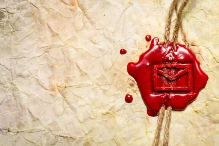 seal wax: Closeup of envelope symbol imprinted in red sealing wax