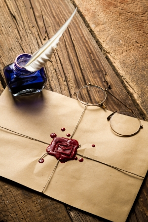 letter envelope: Blue ink inkwell and envelope with red sealant