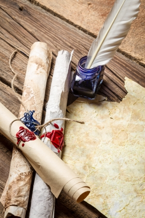 beeswaxseals: Ancient scrolls writing by feather with blue ink Stock Photo