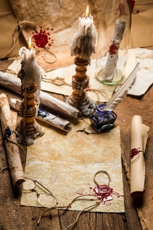 Vintage scrolls and candles are the old scribe Stock Photo