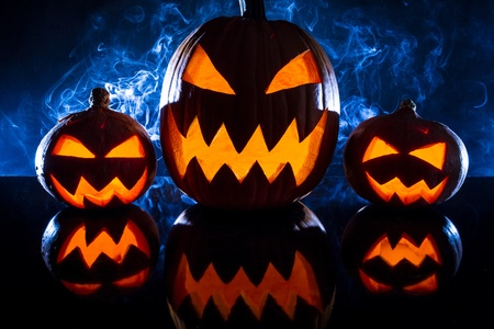 jack o latern: Group pumpkins for Halloween on a blue background