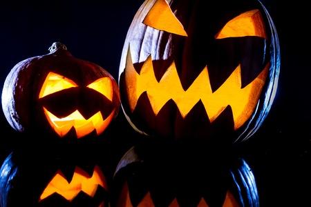 jack o latern: Close-up two strange pumpkins for Halloween