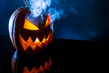 Smoke rising from the pumpkin for halloween photo