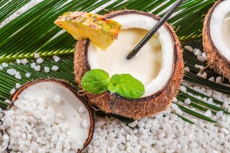 daiquiri alcohol: Closeup of pinacolada drink served in a coconut