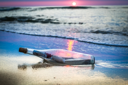 A bottle with a message thrown by the sea photo