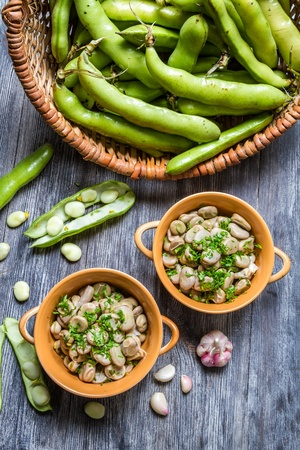 Broad beans served with parsley and garlic