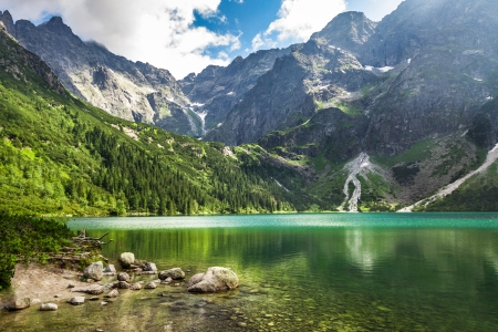 recreational area: Crystal clear mountain lake and rocky mountains Stock Photo