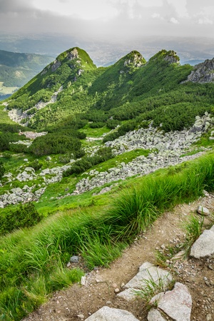 View of the peaks of a mountain path in summer photo