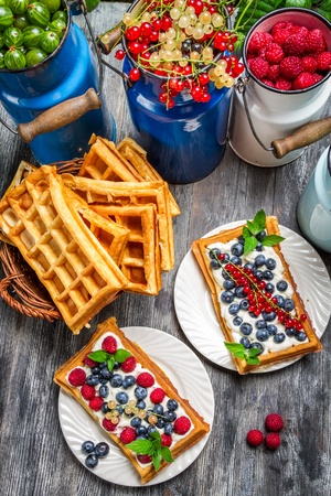 Waffles with fresh collected berry fruit photo