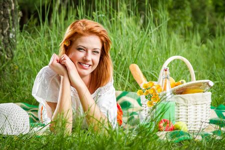 Happy young woman on a summer meadow photo