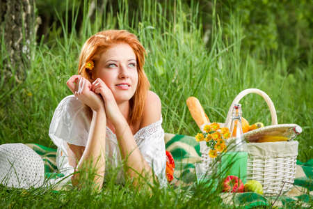 Young woman on a summer picnic photo