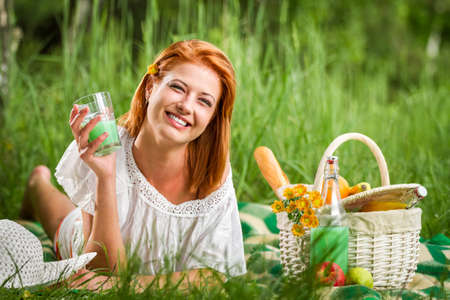 Happy young woman on picnic in summer photo