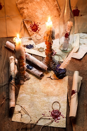 Old scrolls and candles are the old scribes workplace photo