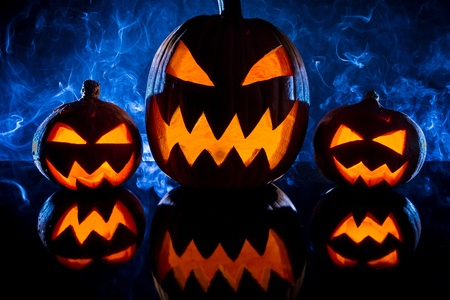 jack o latern: Pumpkins for Halloween on a blue background