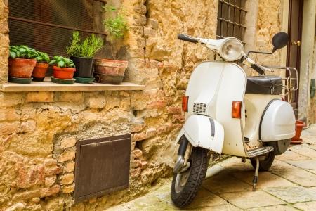 tuscany: Vintage scene with Vespa on old street