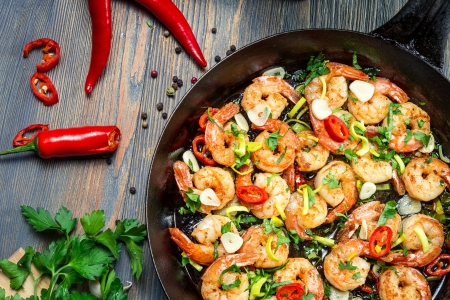 mediterranean cuisine: Shrimps fried on pan with fresh herbs