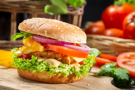 Homemade hamburger with chicken, tomato  and onion photo