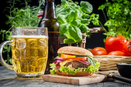 Homemade burger and a cold beer photo