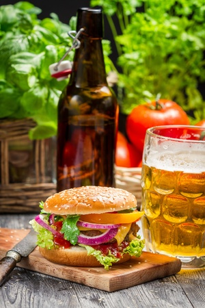 Fresh homemade burger and a cold beer photo