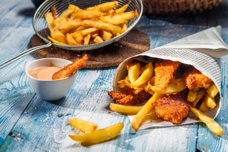 eating fish: Fish & Chips served in the newspaper Stock Photo