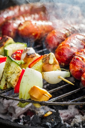 Sausages and skewers on the grill photo