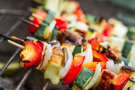 broiling: Skewers with chiken and vegetables on the grill