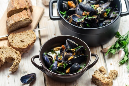 Fresh ingredients for a dish cooked with mussels photo