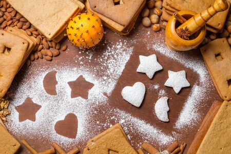 Decorating gingerbread cookies with icing sugar photo