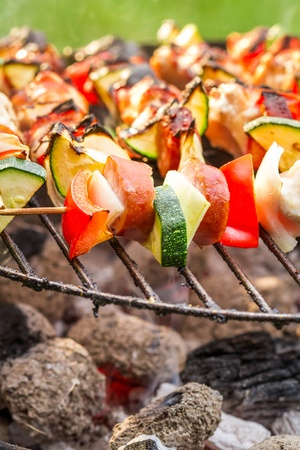 Hot skewers with vegetables on the grill photo
