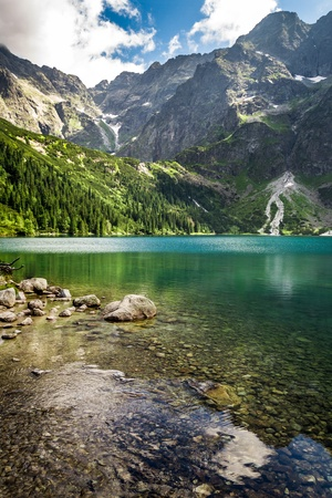 Mountain lake in summer on the background of rocky mountains photo