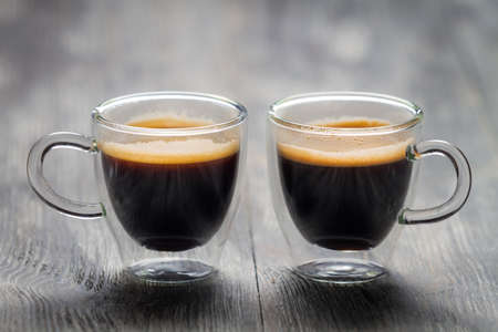 Closeup of two small cups with espresso photo