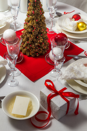 Wafer and gift on Christmas table photo