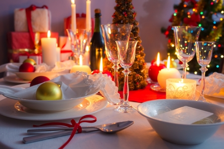 Christmas dishware on the white and red table