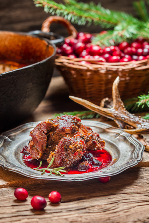 Venison with cranberry sauce and rosemary photo